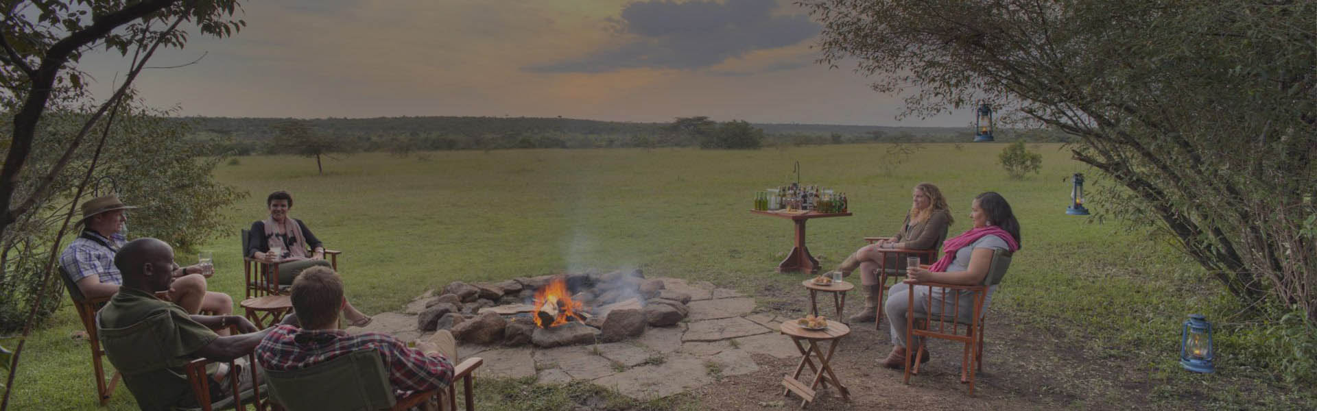 Guests at the fire pit at Encounter Mara