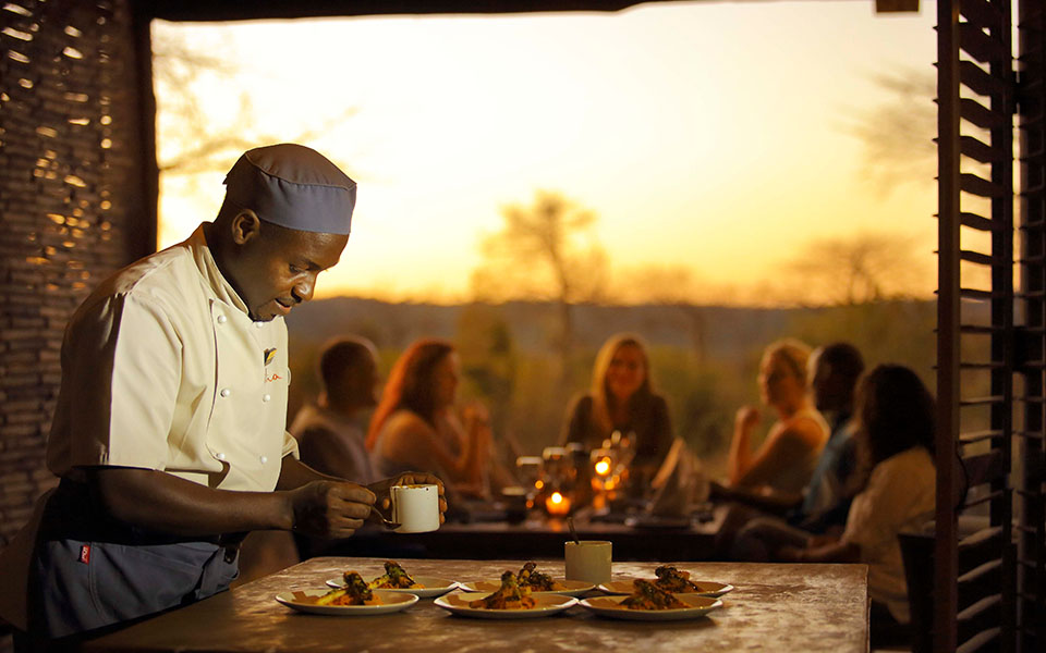 Chef Rama at the Jabali Private House hosting a cooking class with guests.