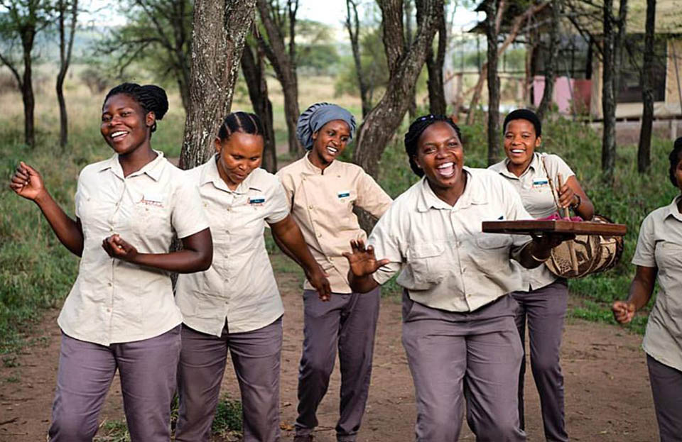 The wonderful women of Dunia Camp welcome each and every guest with a song and dance.