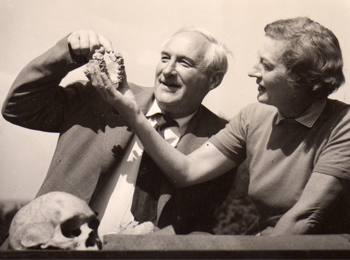 Mary Leakey, a British paleoanthropologist and her husband with fossil