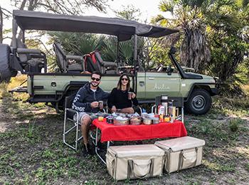 Couple having a bush lunch on safari
