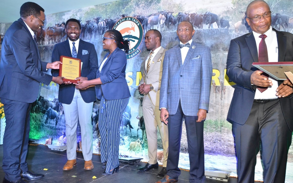 Accepting the award for Best Tour Operator at the TANAPA Tourism Awards 2019.